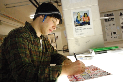 David Smalls, a first-year Sheridan art fundamentals student, works away on a piece.